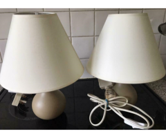 A pair of biscuit colour lamps cream shades