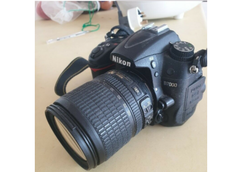 Used Nikon D7000 + 4 Lenses 2 batteries and a bag.